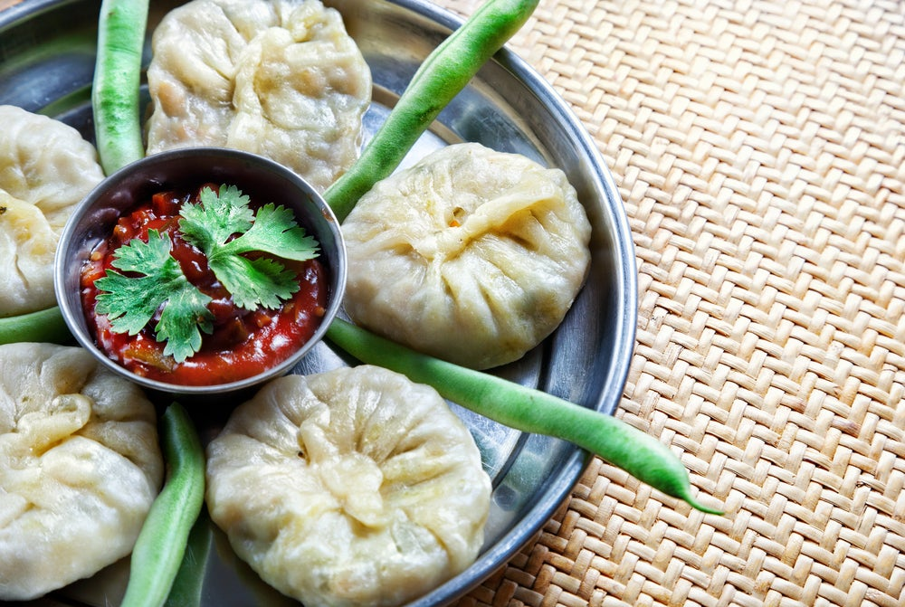 traditional dumpling momo served with red chatni