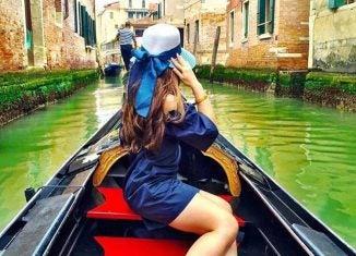 a woman in a gondola in venice italy
