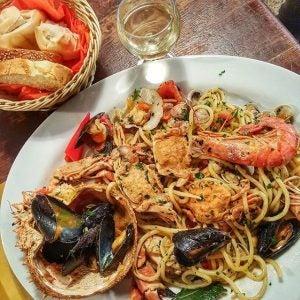 a plate of bigoli with shellfish