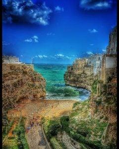 a small cliffside beach in polignano