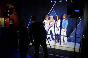 two people checking out a display at the abba museum stockholm sweden