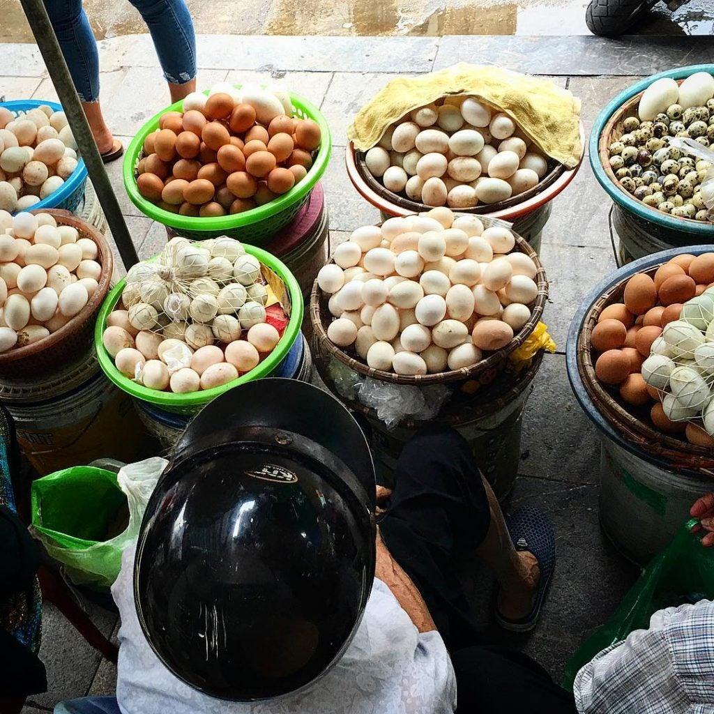a customer buying eggs don xuan market hanoi
