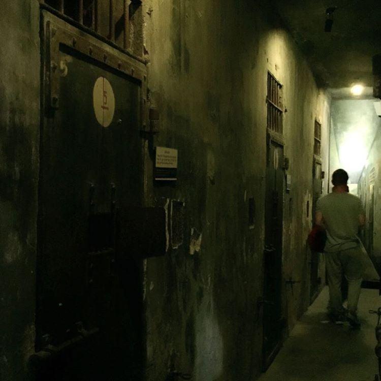 people walk through hoa lo prison hanoi