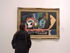 a person looking at a painting in the national gallery dublin