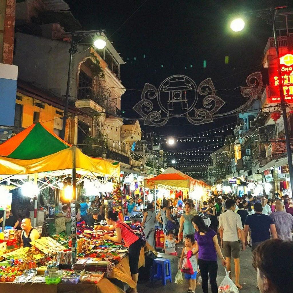 shoppers at the night market hanoi