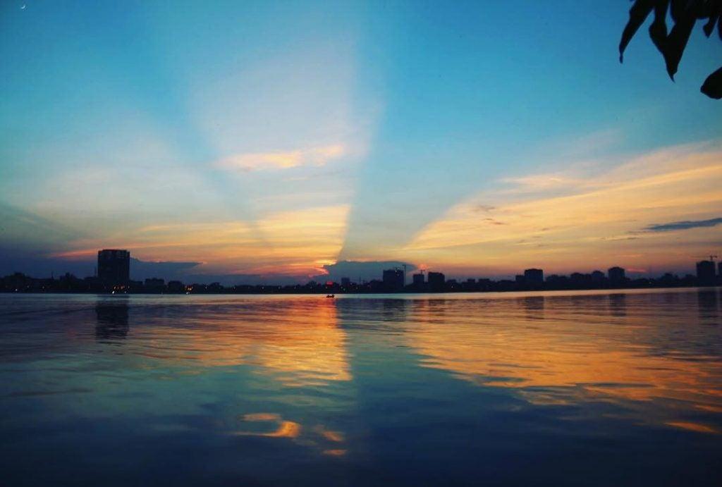 a sunset over tay ho lake