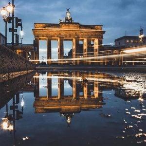 brandenburg gate with a long exposure car light in berlin