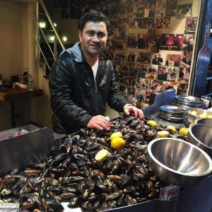 a man selling stuffed mussels in istanbul