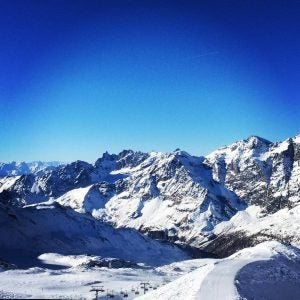 a chairlift cuts through peaks in snowboarding season in cervinia italy