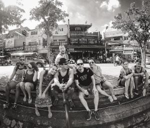 a group of young travellers take a selfie