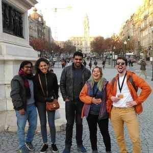 a walking tour group smiles during a break