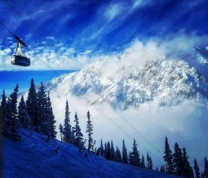 a tram bring snowboarders up the hill at snowbird utah