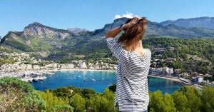 a woman looks over the bay at soller mallorca, best beaches of the balearic islands