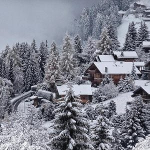 snow covered cabins in the hills of verbier switzerland