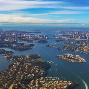 an aerial view of sydney harbour with the city skyline