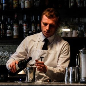 a bartender mixes a cocktail at termini bar london