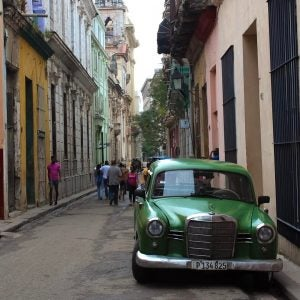 a classic green car parked in the streets of havana cuba