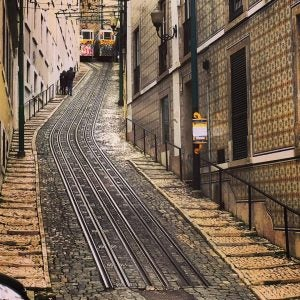 trams going downhill in lisbon portugal