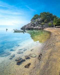 a deserted rock beach on the makarska riviera