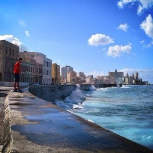 a man fishes along the malecon in havana cuba