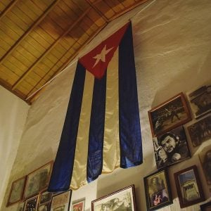 photographs and the cuban flag at the revolution museum havana cuba