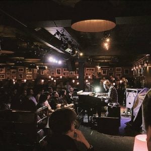 a live jazz band plays at ronnie scott's london