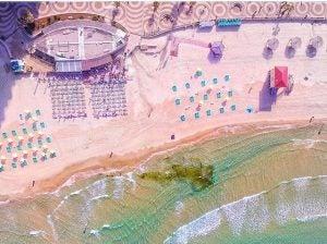 an aerial shot of the beach in tel aviv