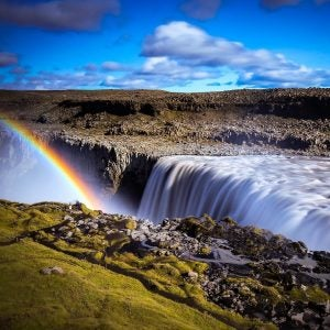 a rainbow at detifoss falls in iceland