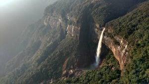 an aerial view of nohkalikai falls india
