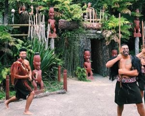 maori warriors guard a hut at tamaki village