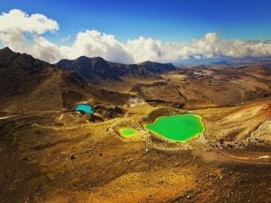 a green lake at tongariro national park new zealand