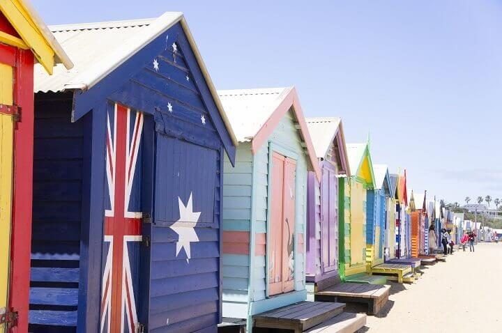 Reasons to travel to Melbourne_ Opodo Travel Blog_small bathing houses on white sandy beach at Brighton Beach